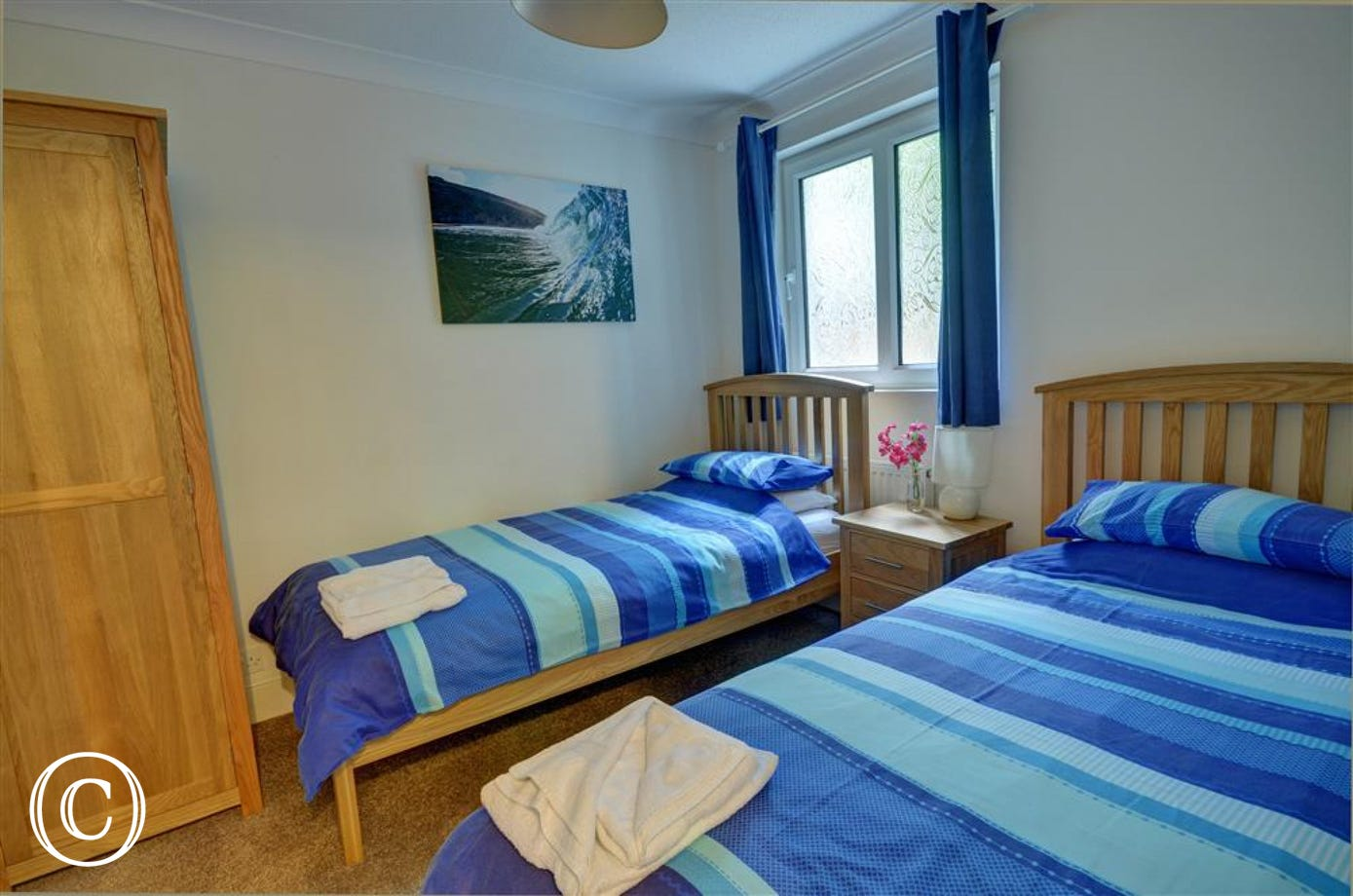 Comfortable colourful twin bedded room