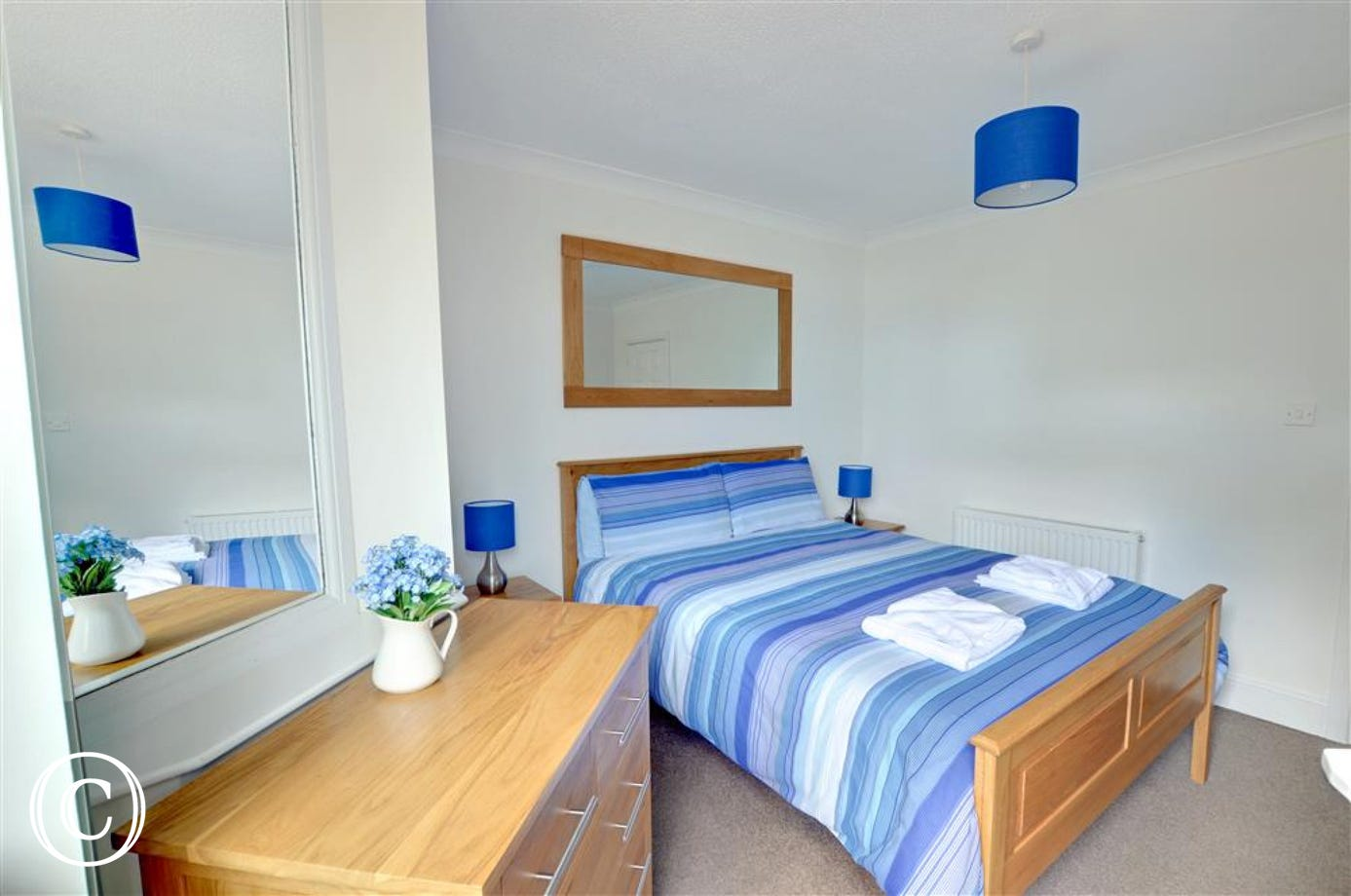 The lovely master bedroom with kingsize bed and ensuite bathroom