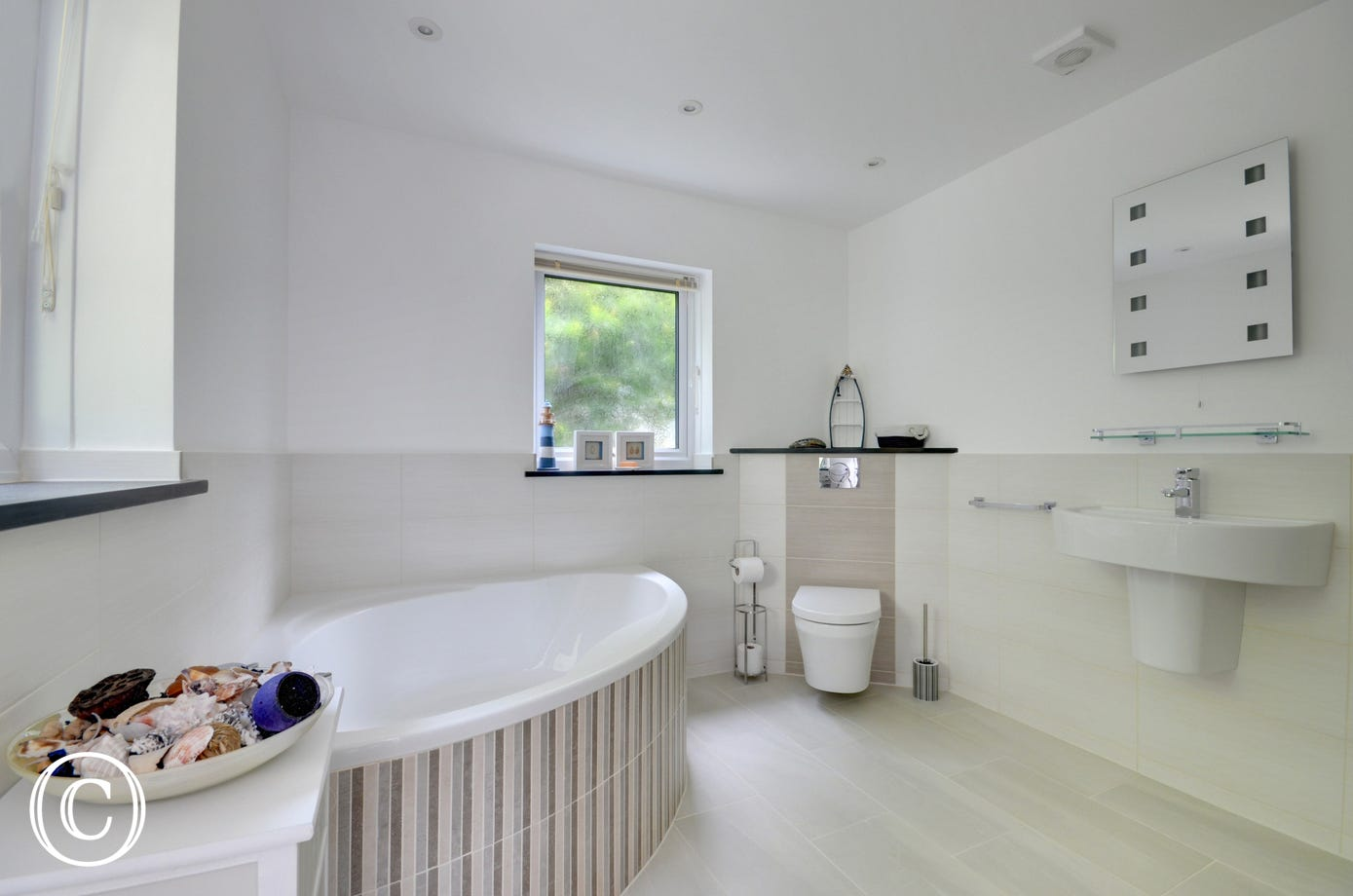 Large family bathroom complete with underfloor heating, luxurious corner bath and walk-in shower