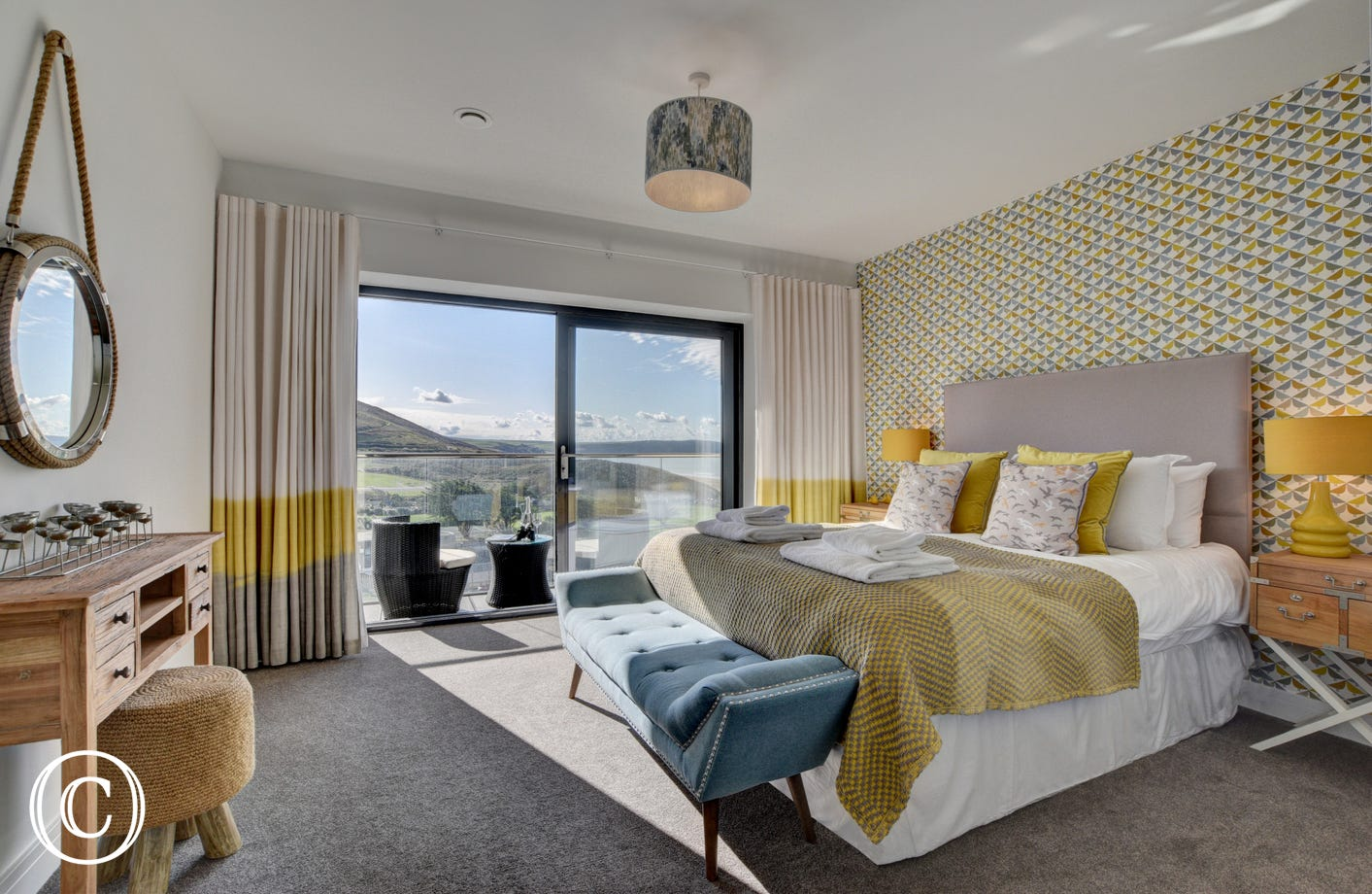 The spacious master king size bedroom has been stylishly decorated in yellows and greys