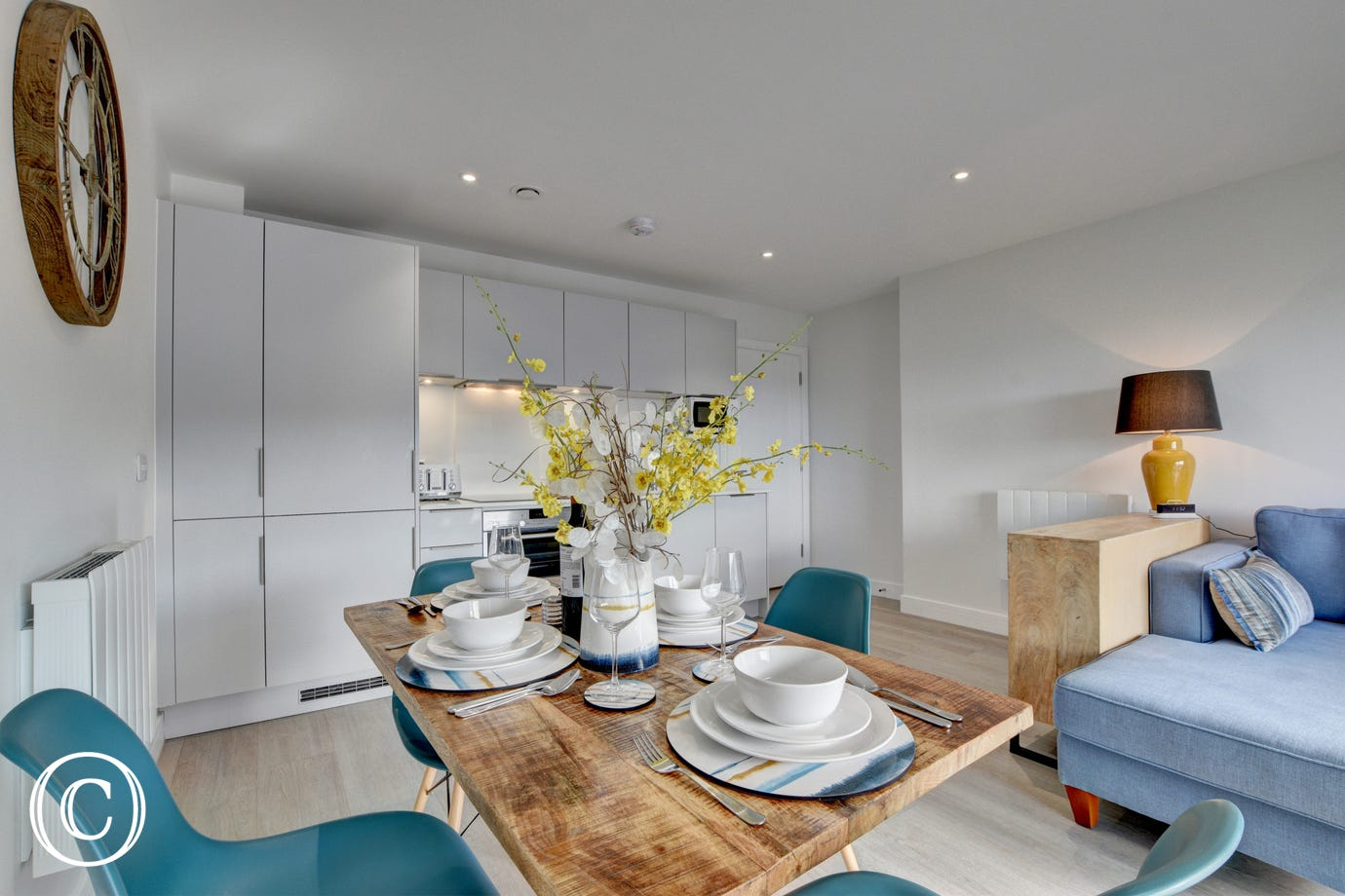 The well equipped kitchen area with granite worktops adds to the style, together with a dining table
