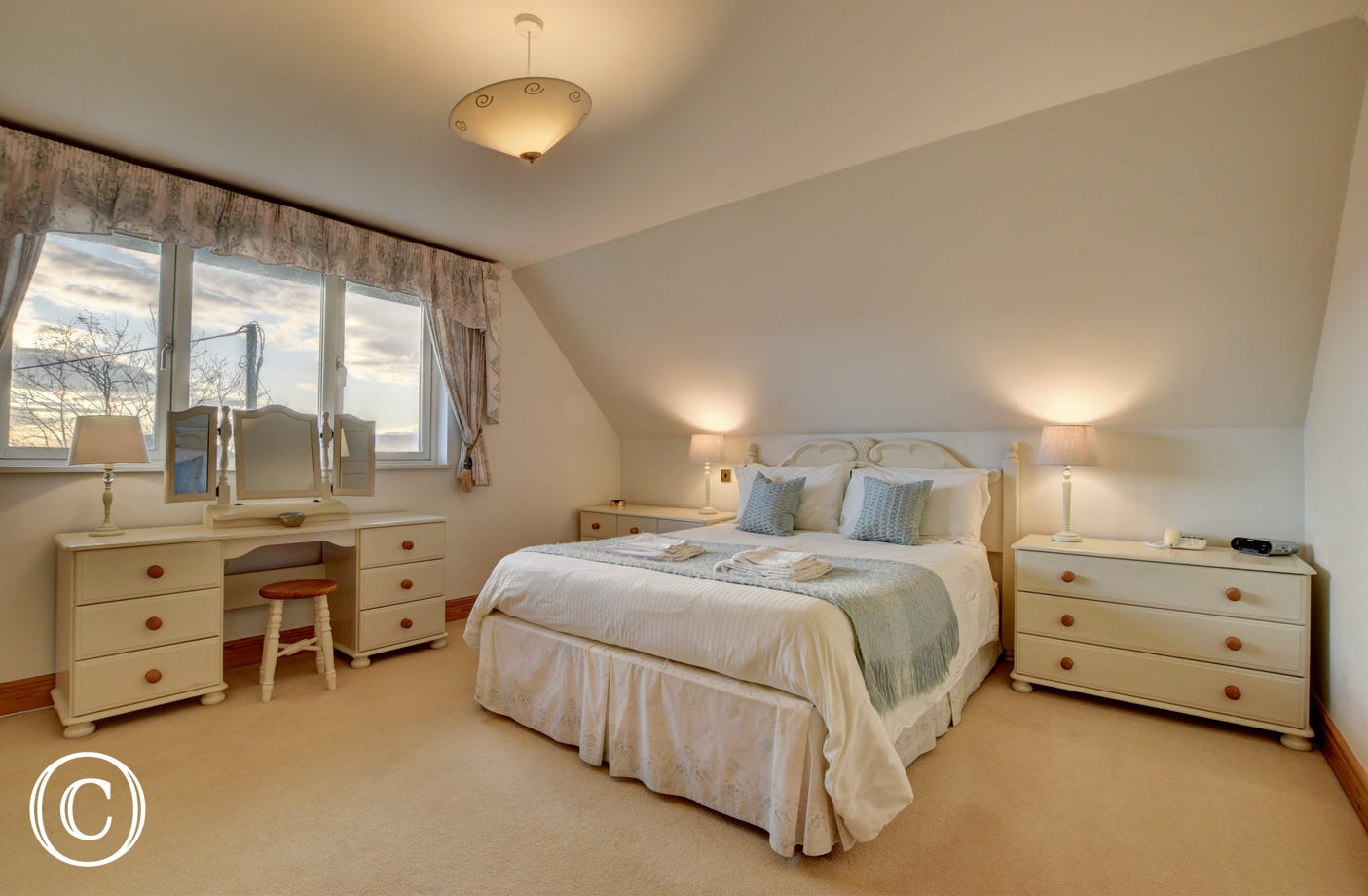 The beautiful master bedroom has views over Croyde, sand dunes and the sea