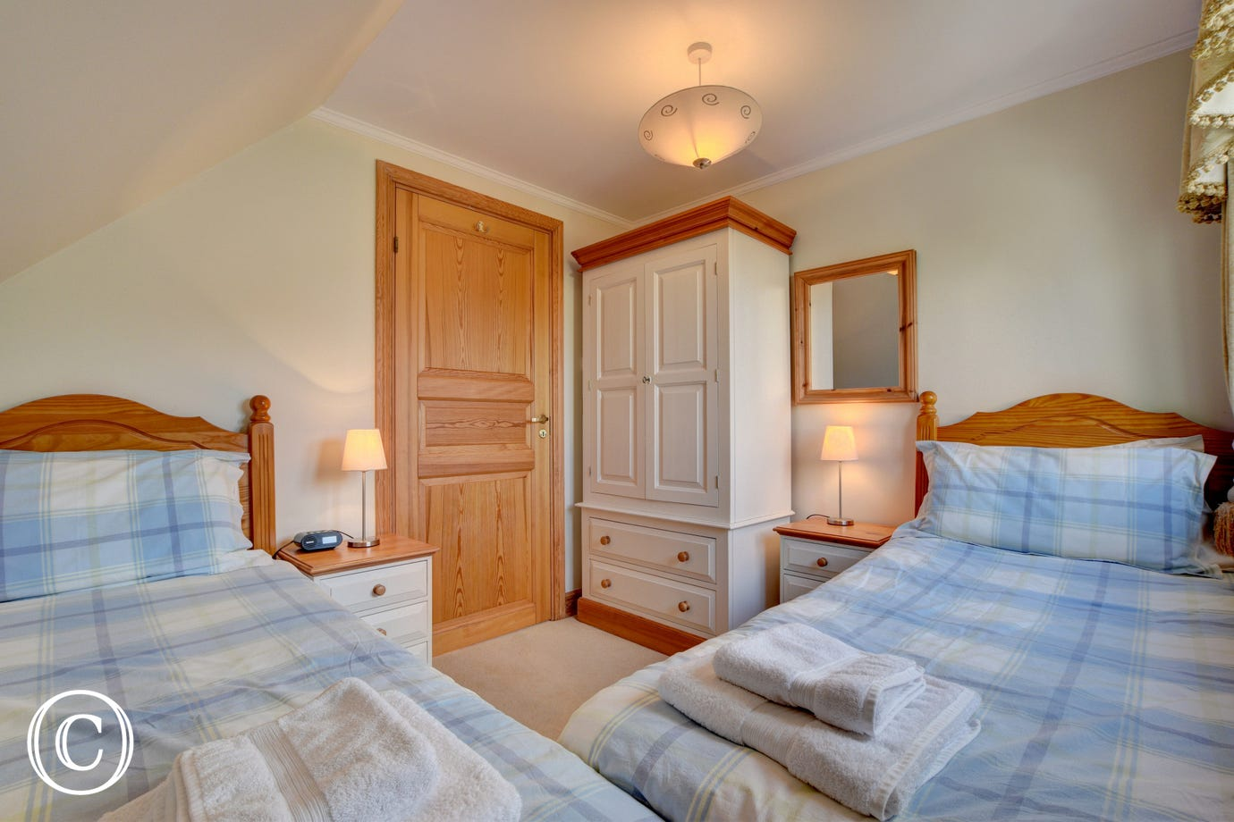 The second twin bedroom with plenty of wardrobe space