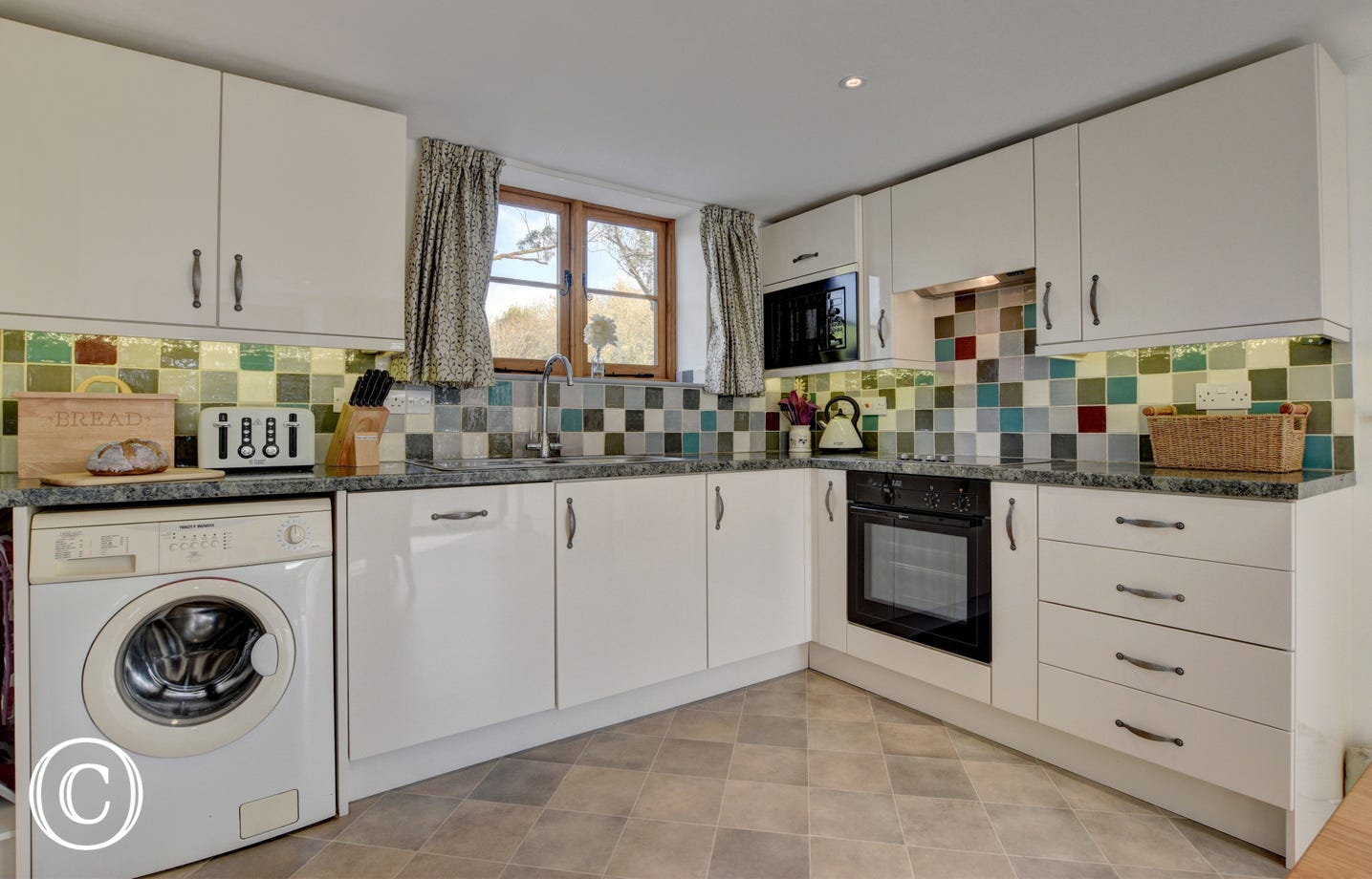 Kitchen/diner with electric hob and oven, microwave, fridge/freezer, washing machine and dishwasher