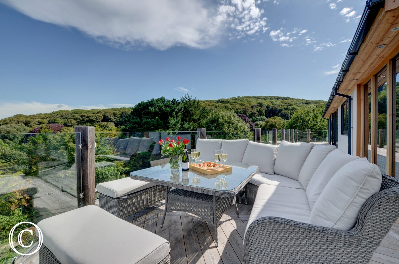 Beautifully comfortable rattan garden furniture on the top terrace