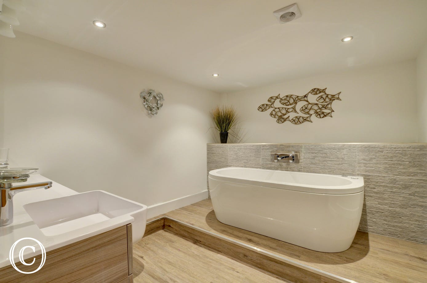The family bathroom is a real indulgence incorporating a deluxe Jacuzzi spa bath with WiFi and mood lighting