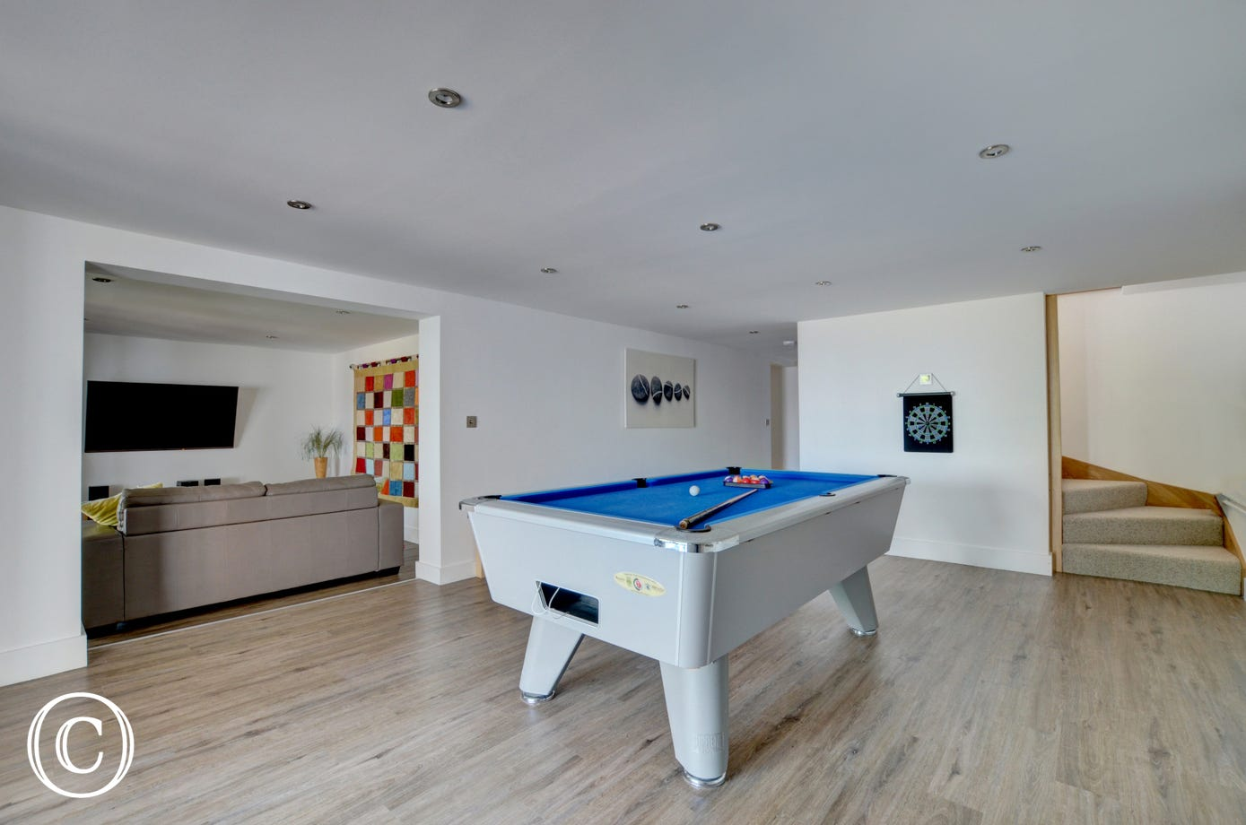 The pool room with second sitting room, ideal for the children