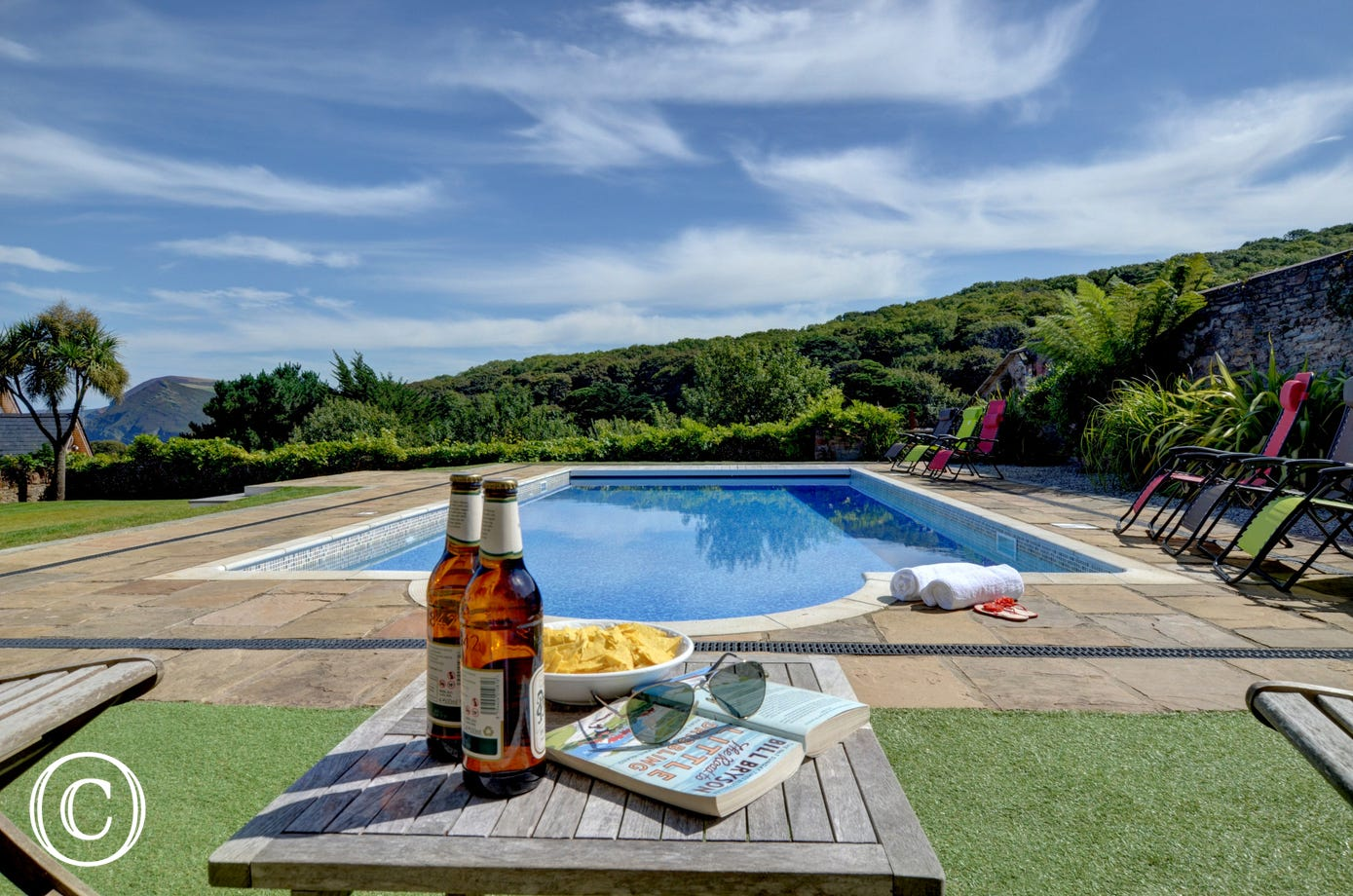 Enjoy a cool beer and a dip in the pool after a day at the beach