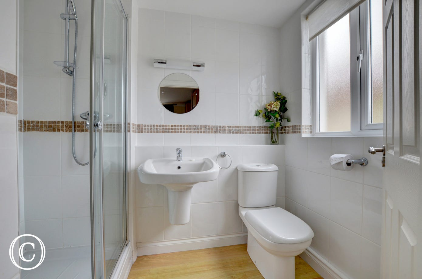 Ensuite bathroom with shower, WC and basin