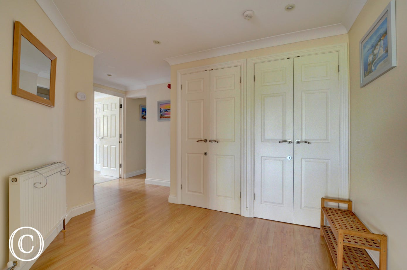 The hall leads into a very spacious open plan living room with stylish kitchen and dining area