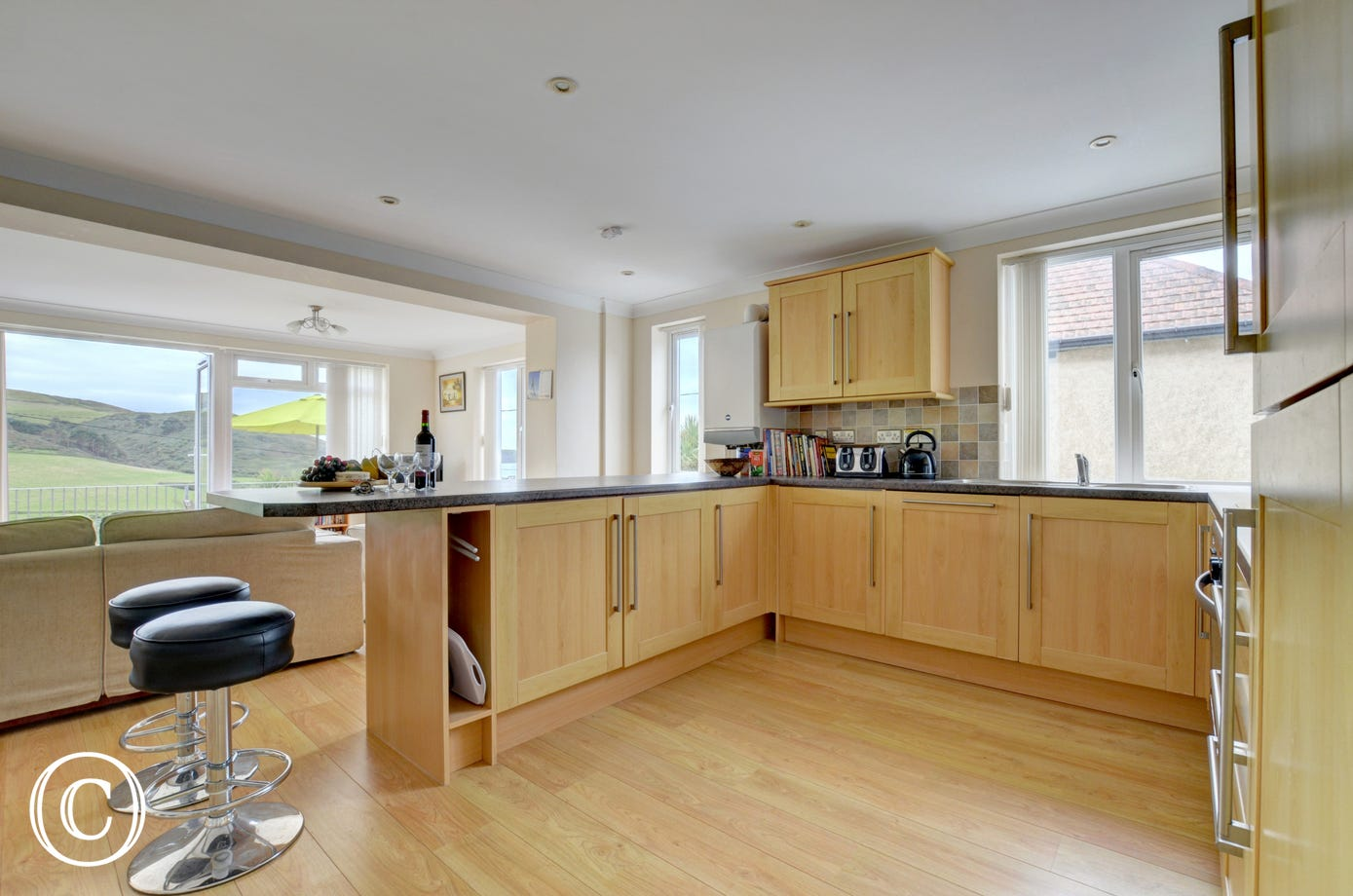 The kitchen has modern fitted units with ample storage space