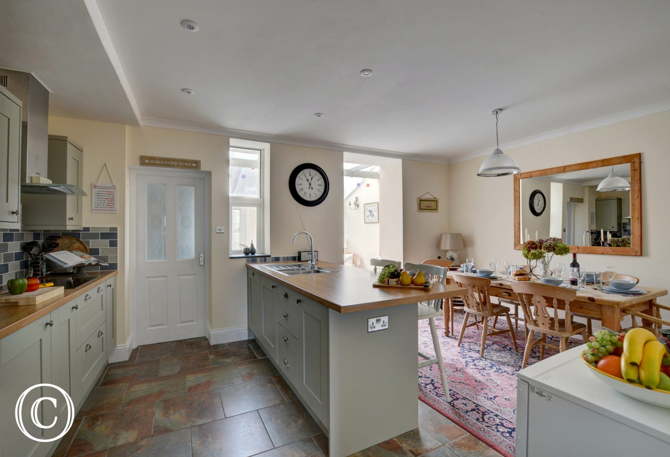 Wonderful open plan kitchen and dining area, with access to conservatory