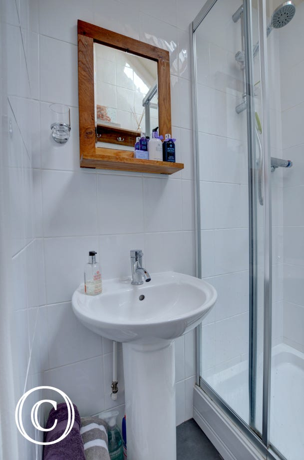 Ensuite bathroom is located on the top floor