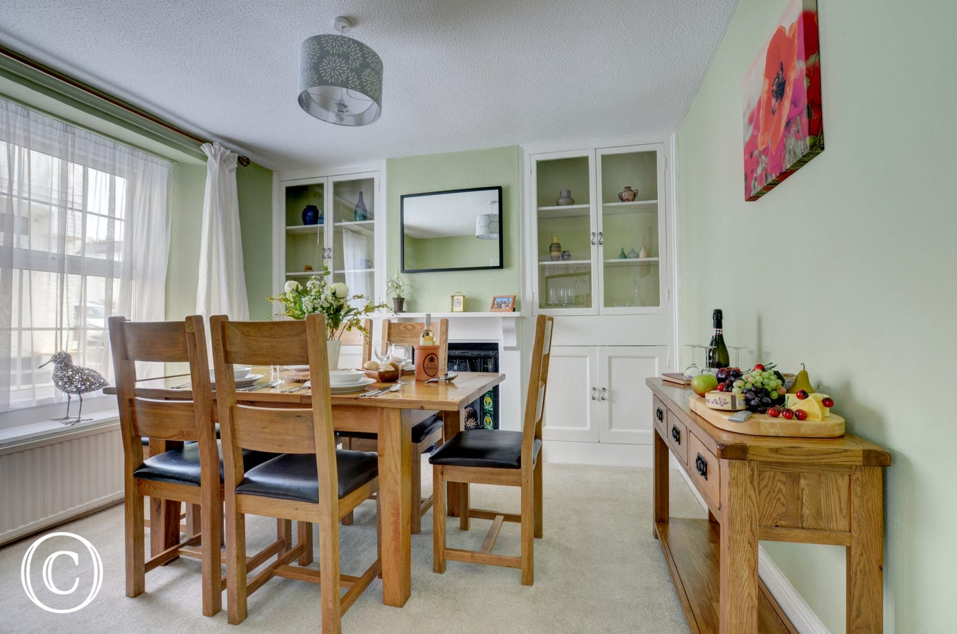 The stylish dining room comfortably seats 6