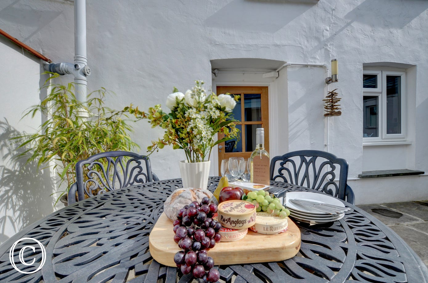 Enjoy a cheese board and a glass of wine on the patio