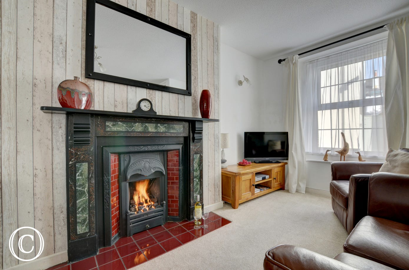 Enjoy watching a film in the cosy sitting room