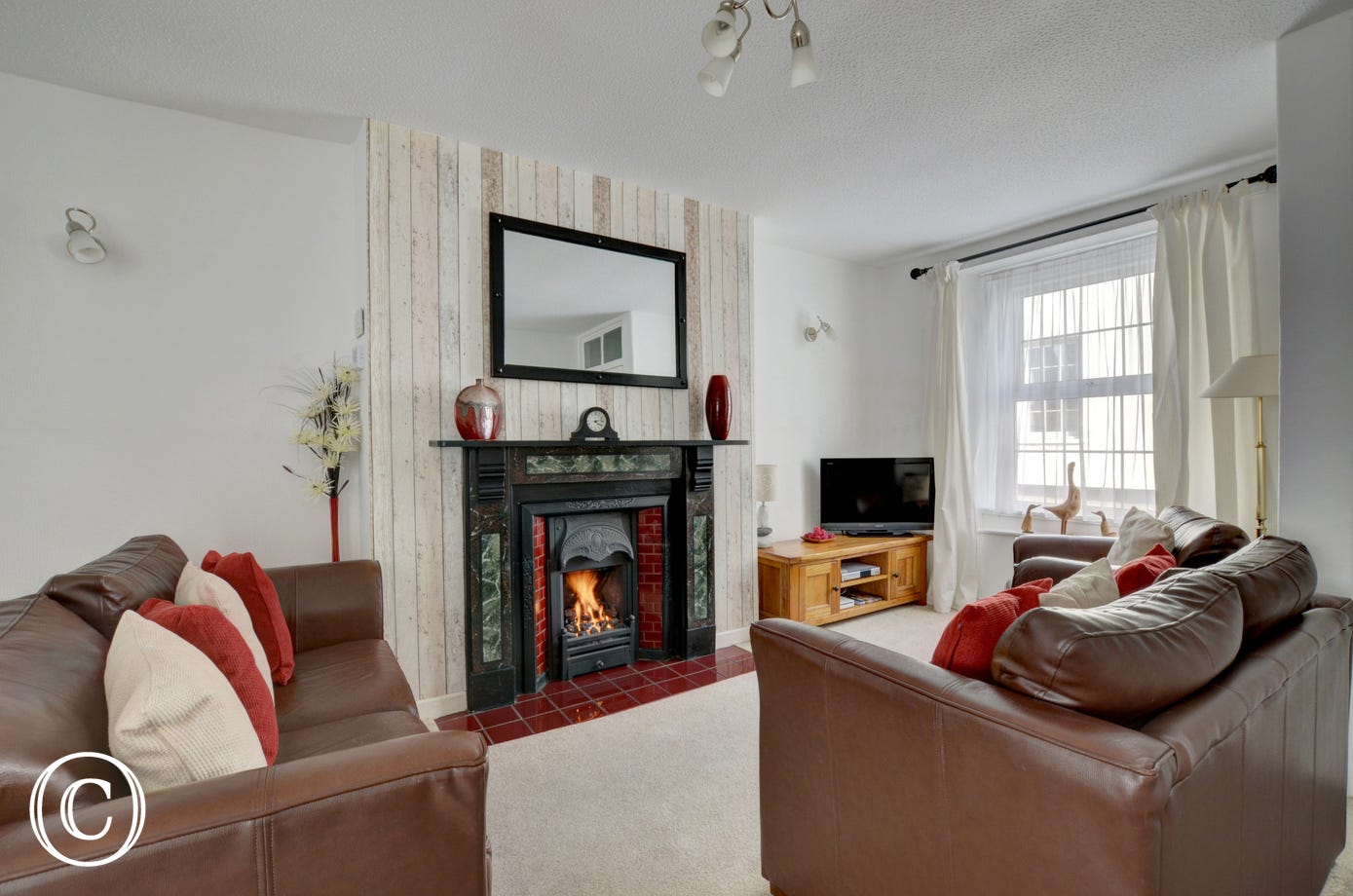Homely sitting room with gas fire