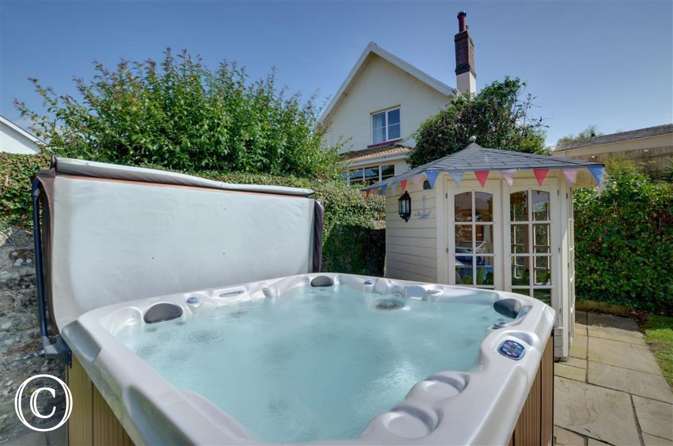 The added benefit of a hot tub in the garden provides an ideal spot for relaxing