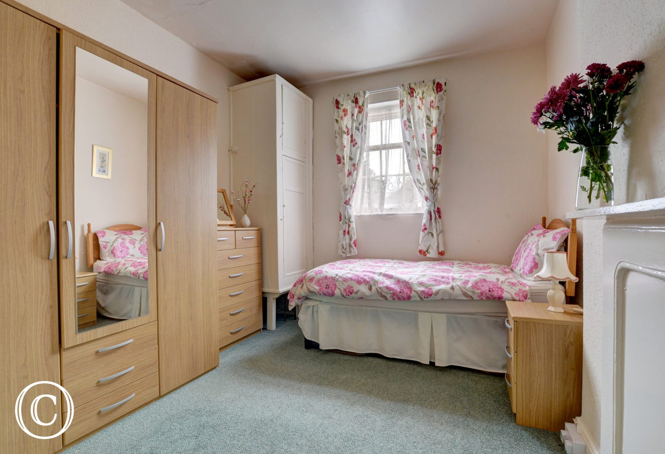 Twin bedded room with ample wardrobe space