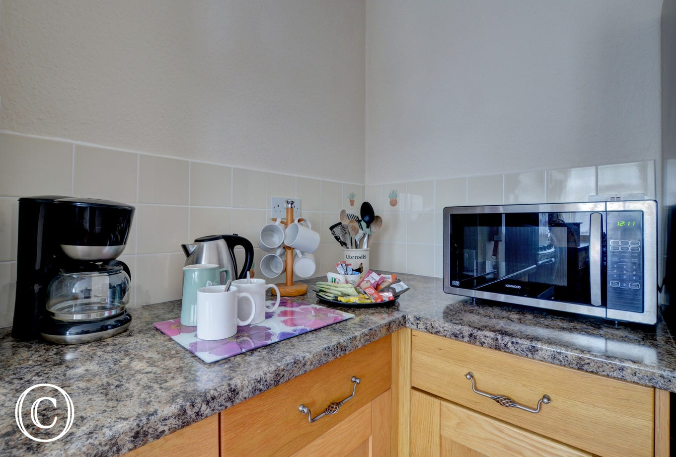 Coffee machine and microwave available in the kitchen