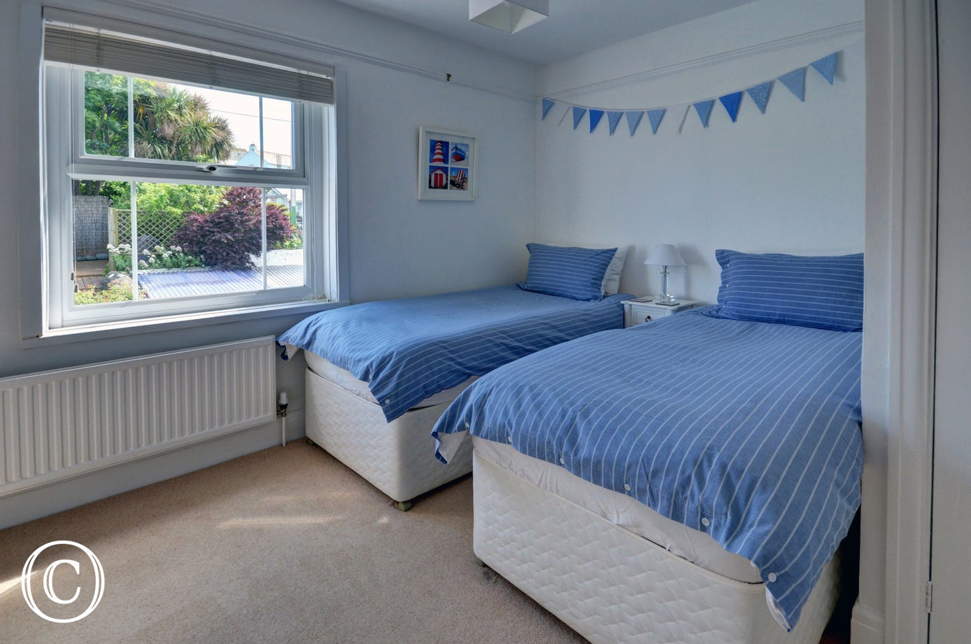 Attractive twin bedroom with views of the garden