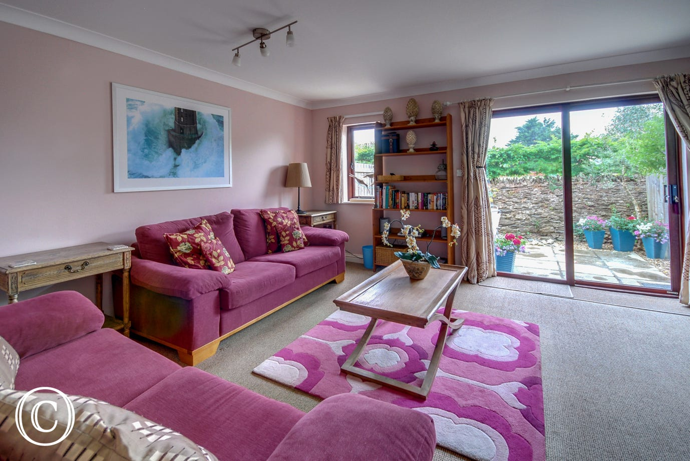 The spacious living room is very comfortable with patio doors leading out onto the pretty south facing courtyard
