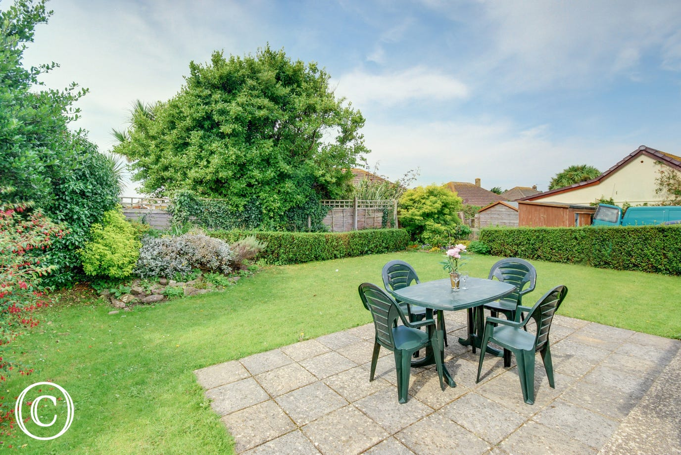 The private fully enclosed level lawned garden is situated at the rear