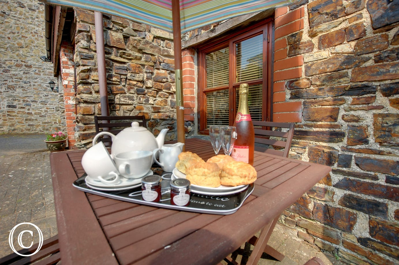 Enjoy a traditional Devon cream tea for two on the patio area!