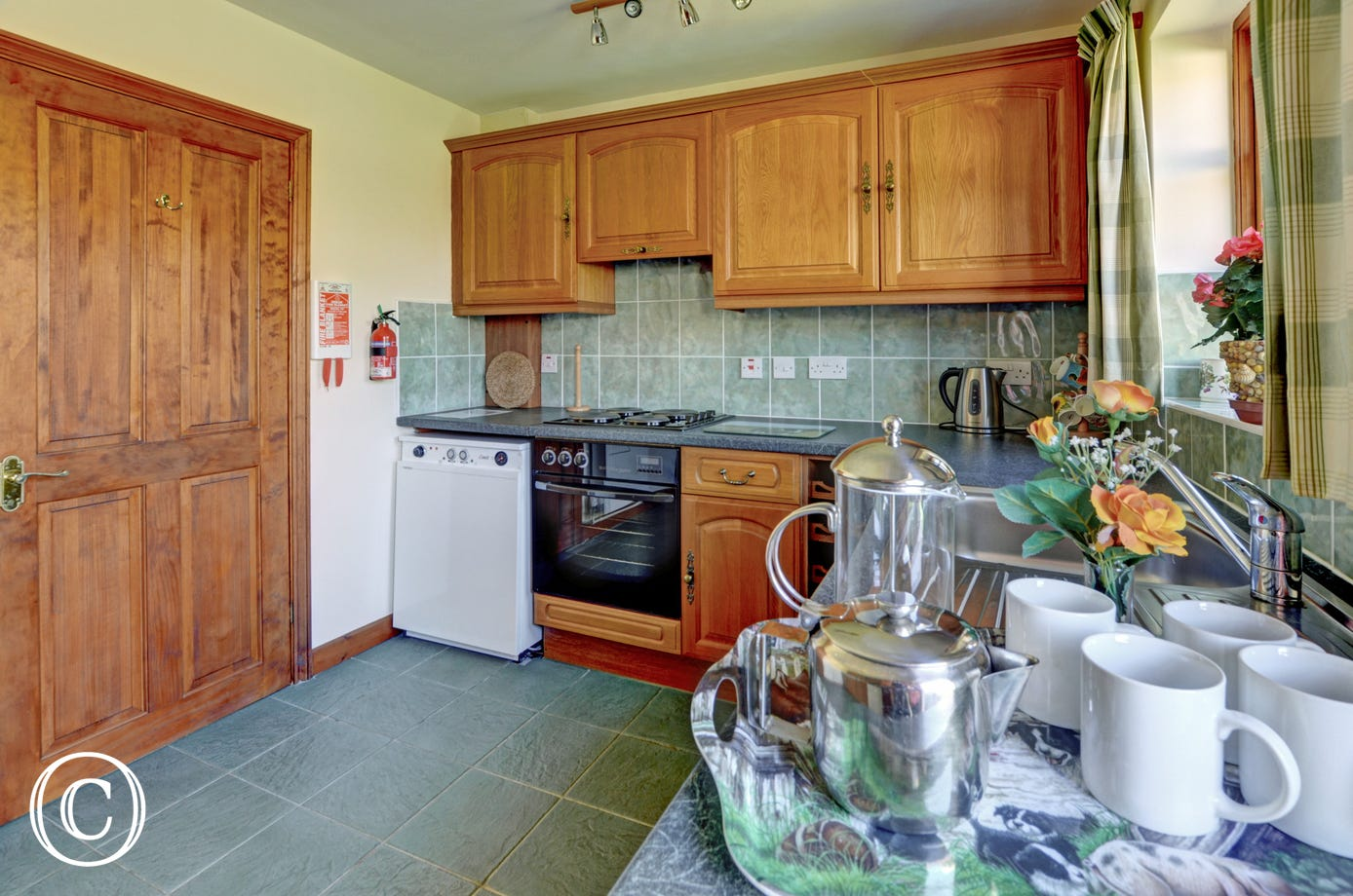 The modern fitted kitchen is well equipped