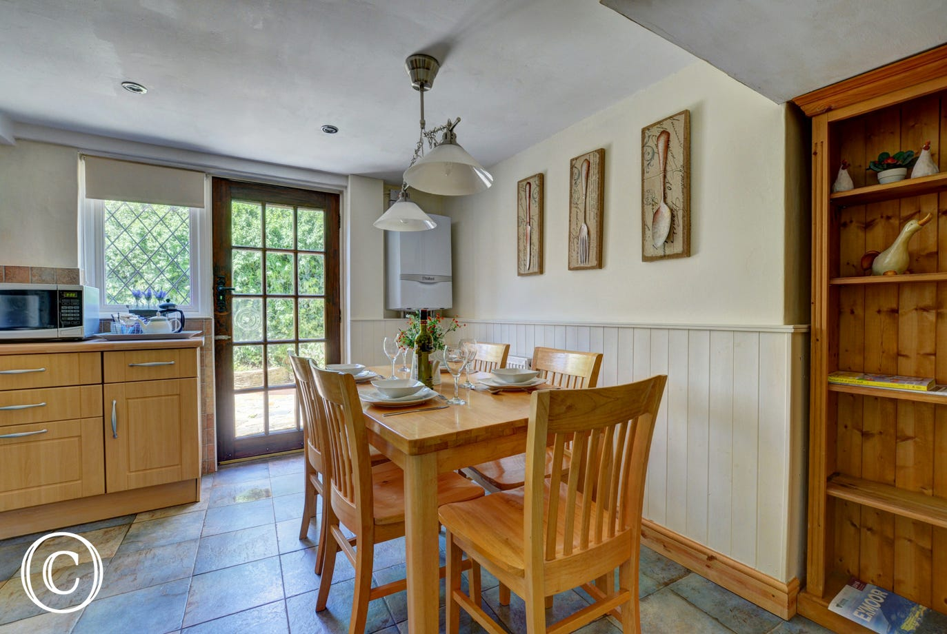 The attractive modern kitchen/dining room has a door out on to the fully enclosed paved rear courtyard