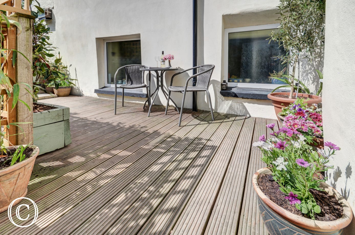 A well thought out fully enclosed terraced patio and garden offers a lovely space to enjoy breakfast or relax after a day exploring the area