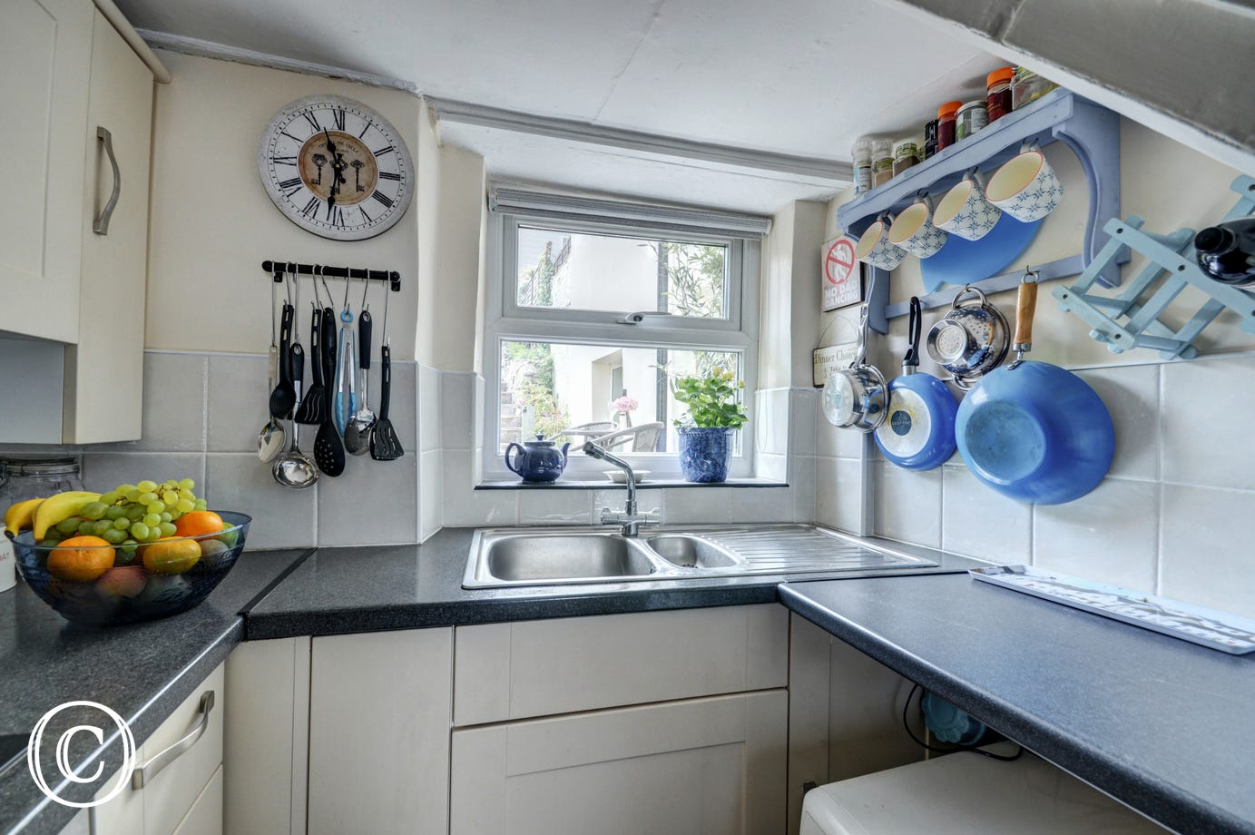 The compact kitchen provides all you will need for dining in