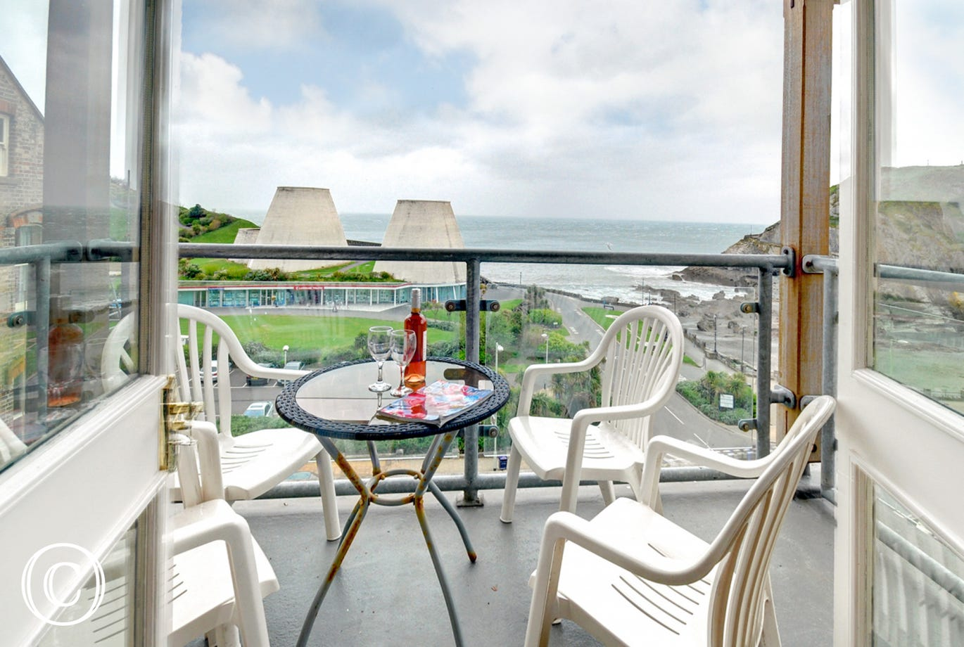 Patio doors open onto the balcony area with a fantastic sea view and covered canopy, a real bonus