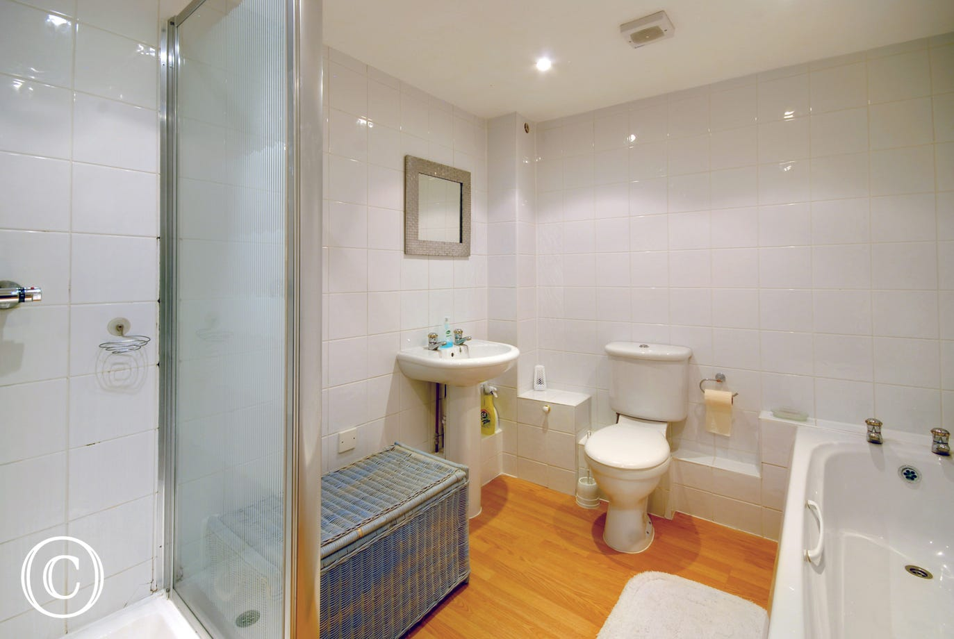 The bedrooms are served by a large spacious bathroom