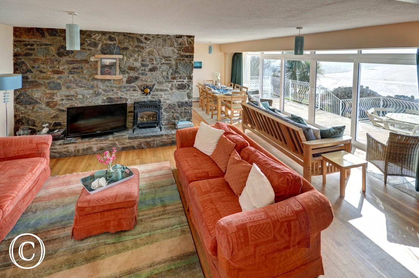 The spacious open plan living area, a joy in the summer and winter alike with stunning views