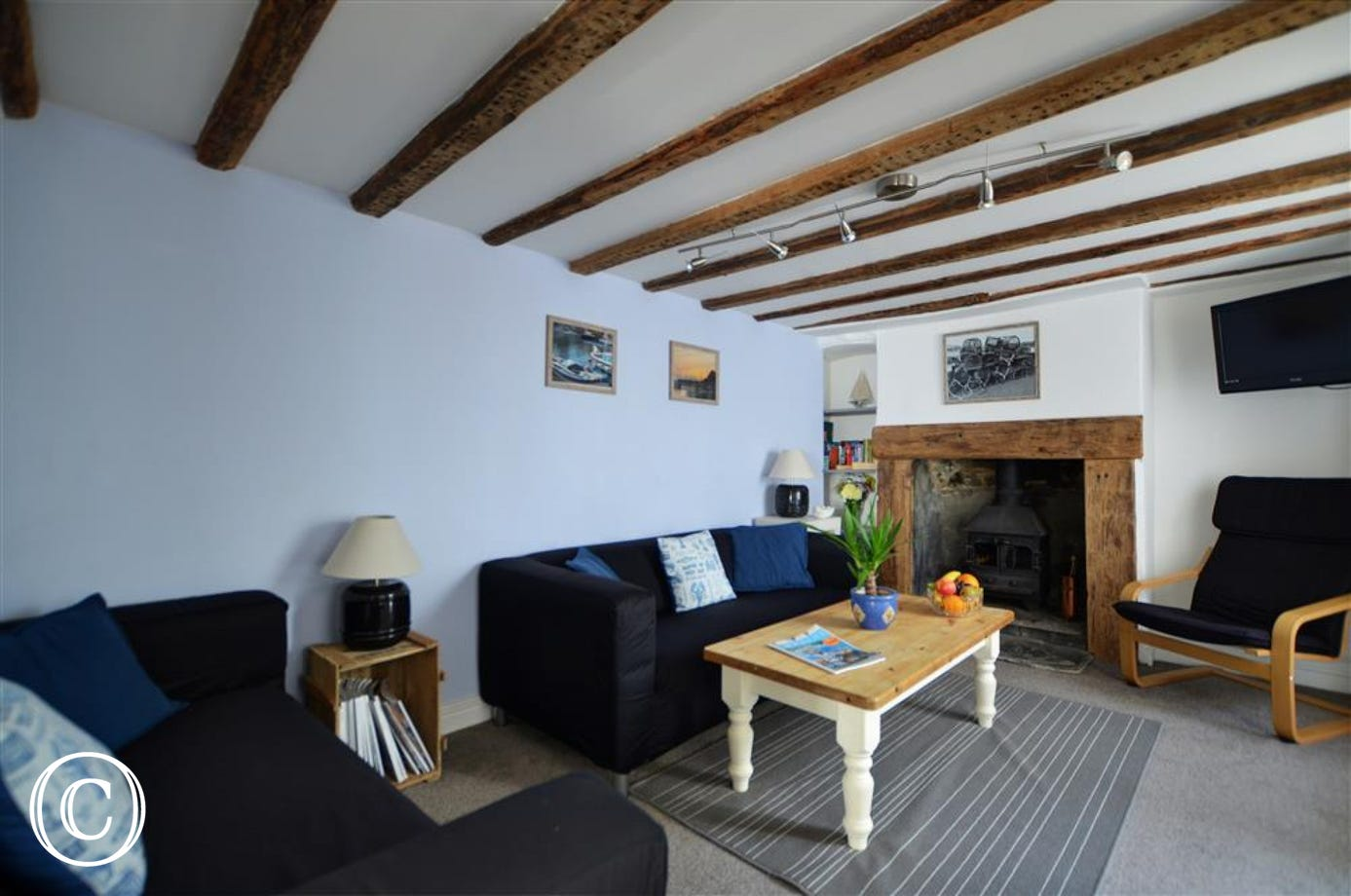 The cottage offers an attractive and cosy beamed lounge with a wood burner in a stone fireplace for comfort in the cooler seasons