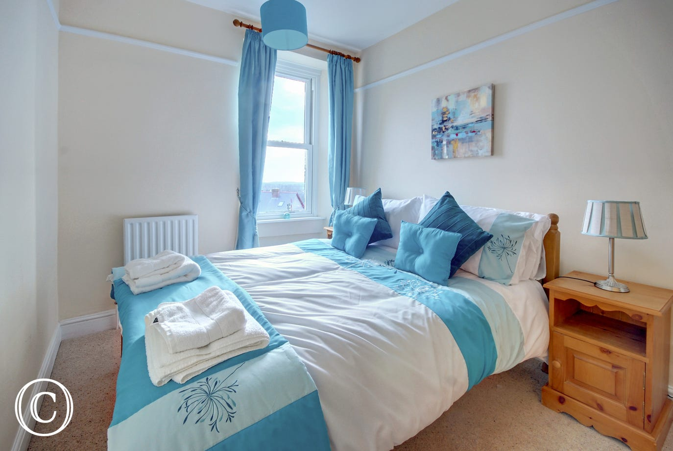 Brightly decorated double bedroom on the top floor of the property