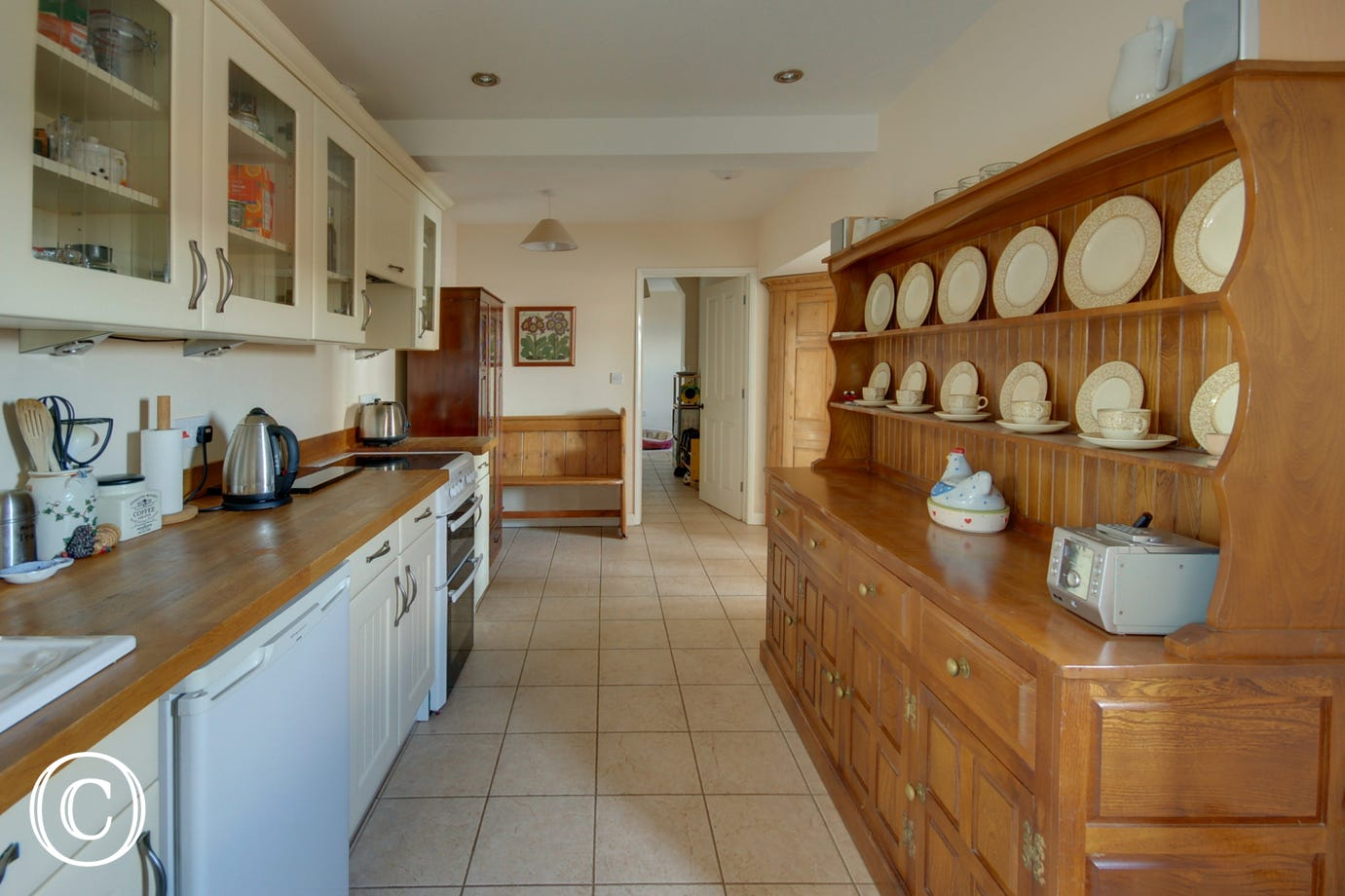The well equipped country style kitchen with large dresser
