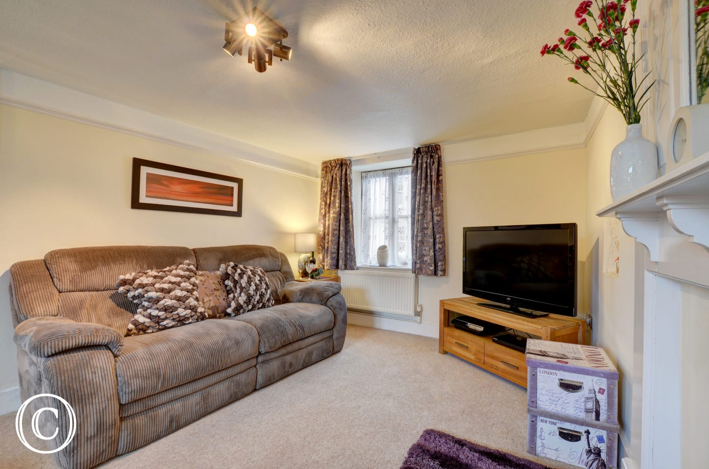 Homely sitting room with two comfortable sofas and a 42 inch TV