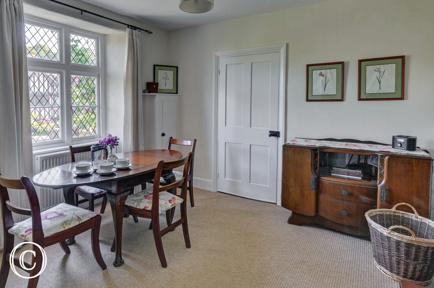 A separate dining room provides lovely views over the village and surrounding hillsides