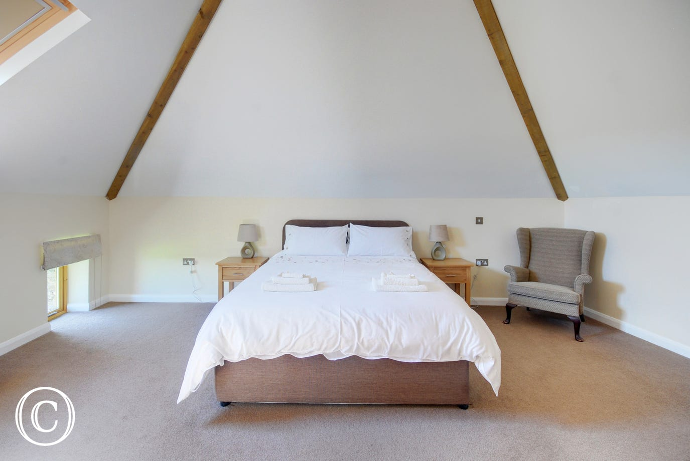 The spacious master bedroom with kingsize bed and ensuite bathroom