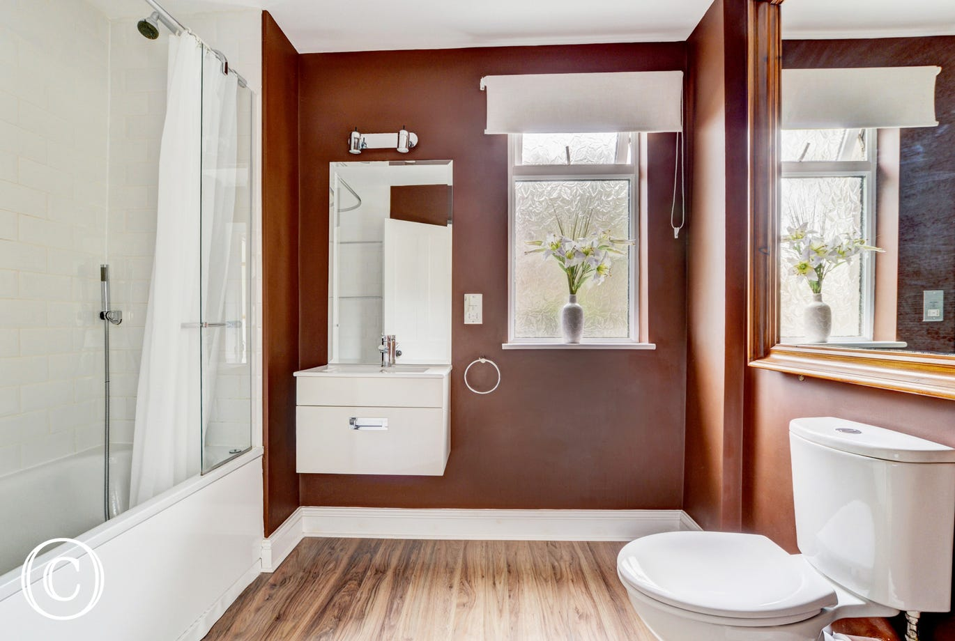 Spacious and modern family bathroom with shower over bath