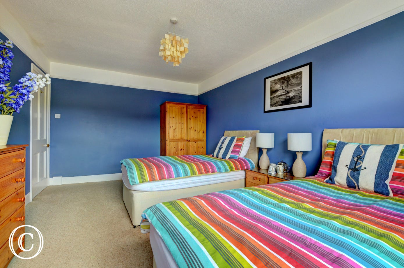 Brightly coloured spacious twin bedroom