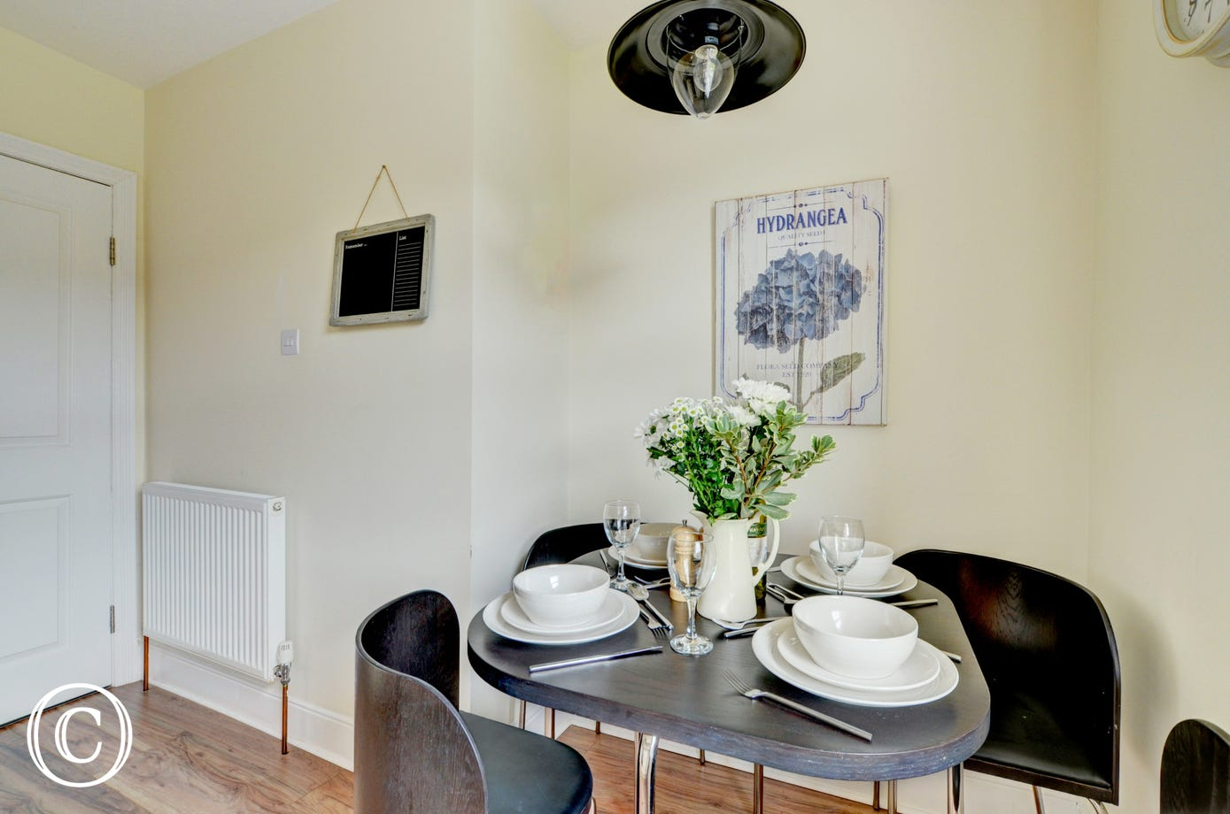 The compact dining table in the kitchen
