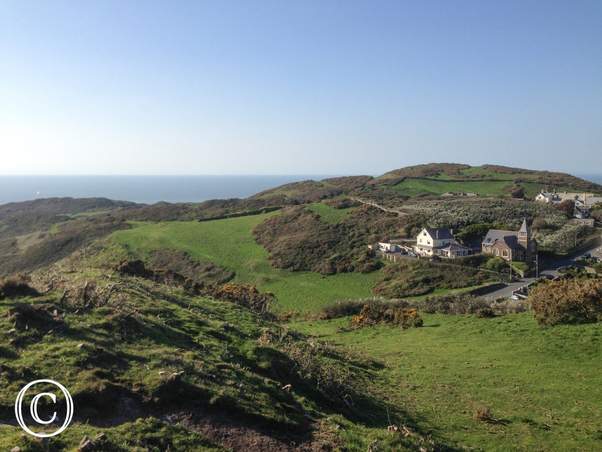 Tucked into the hillside on the edge of the village of Mortehoe with magnificent views