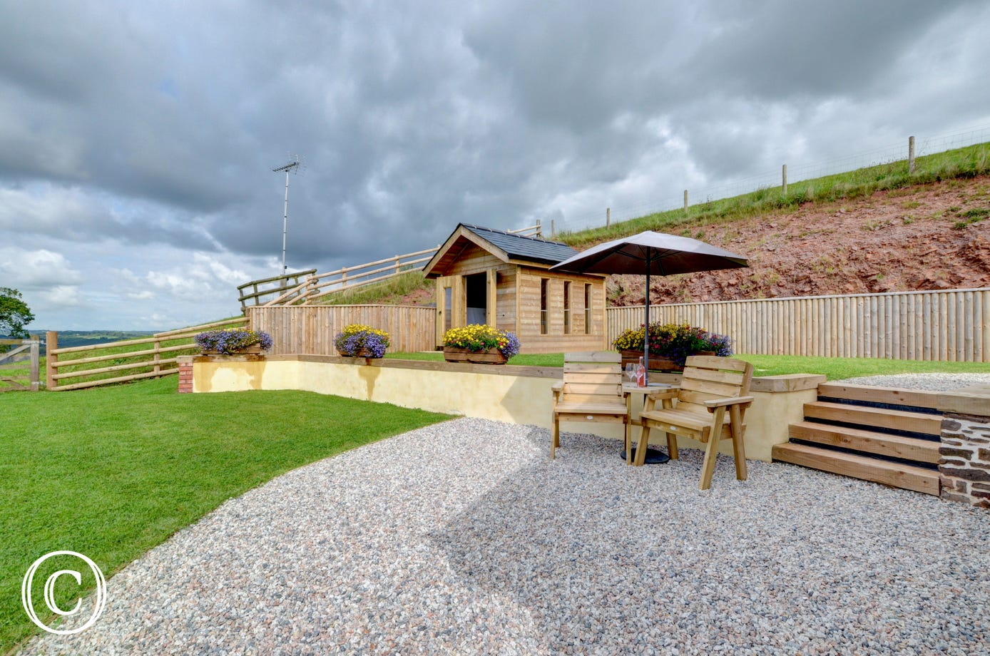 A external view of the patio and summerhouse with hot tub
