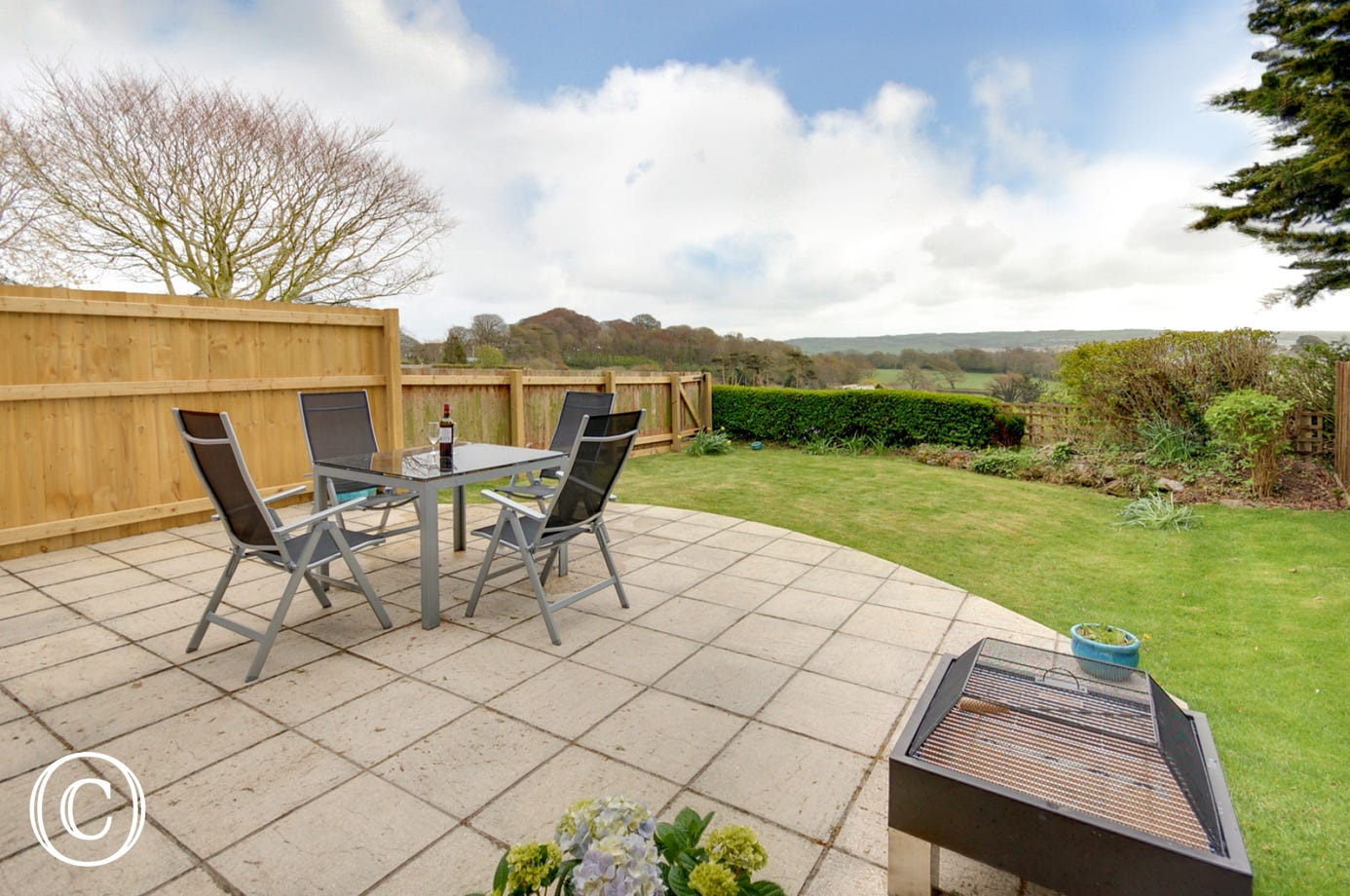 Ideal for enjoying al fresco meals or just a quiet time in the sun, the large patio and fully enclosed garden has garden furniture and a firepit/barbecue