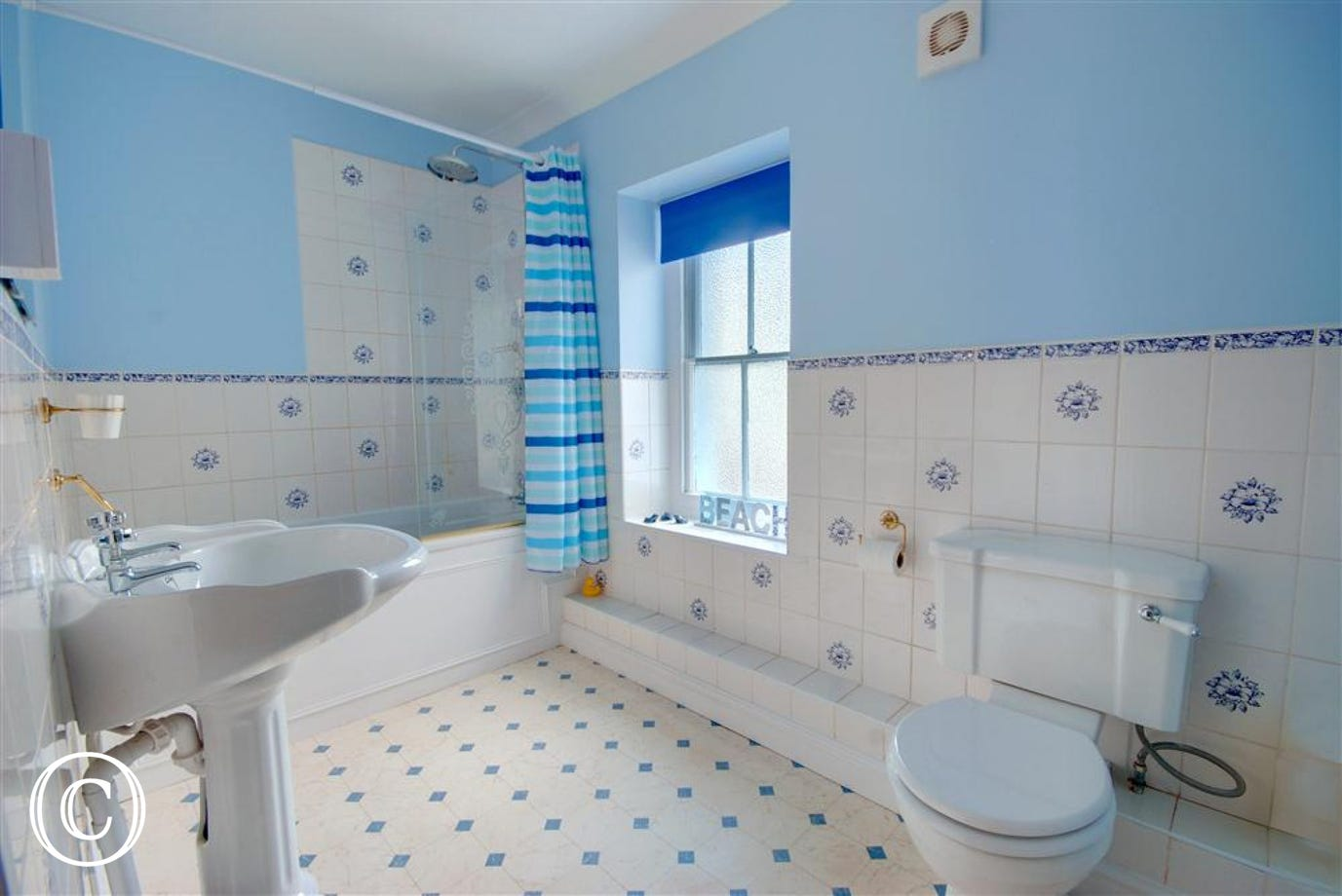 Very spacious bathroom with shower over bath, WC and basin