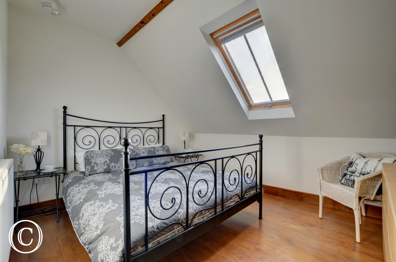 Double bedroom which is open to the high vaulted ceiling and with a balustrade overlooking the living room below