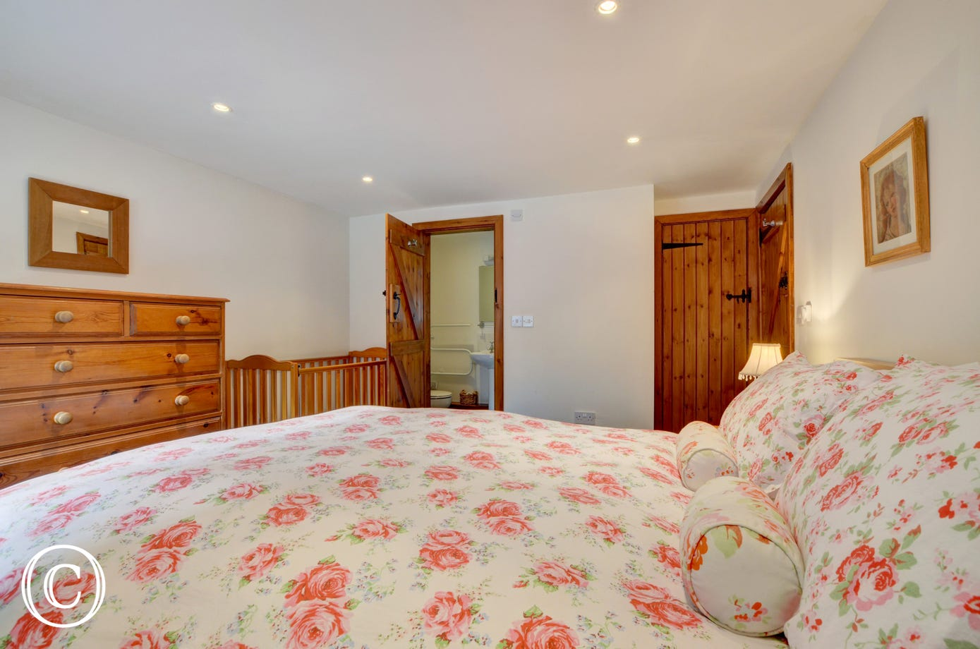 Tastefully decorated master bedroom with kingsize bed and ensuite bathroom